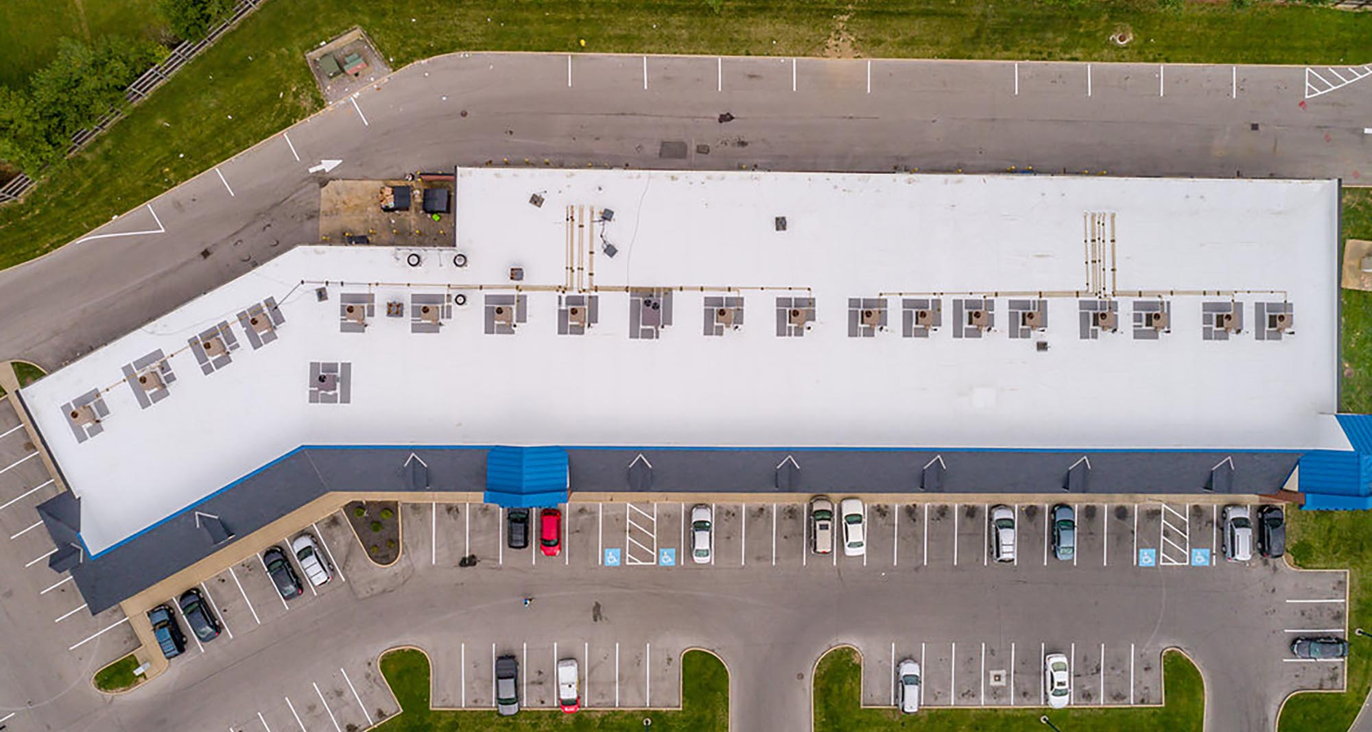 Top View of a Roof and Parking Lot